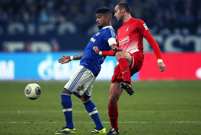 Freiburg's Pavel Krmas (right) challenges Kevin Prince Boateng during Schalke's 2-0 win.