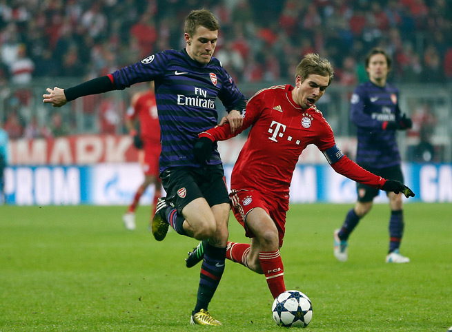 Arsenal's Aaron Ramsey, left, and Bayern's Philipp Lahm will do battle in the Champions League round of 16 for a second straight year after Monday's draw.