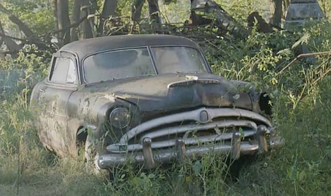 The legendary Mario Andretti's first automotive love, a 1948 Hudson Hornet, growing in the wild.