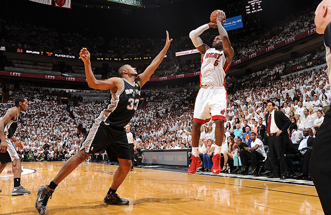 A headband-less LeBron James drilled an open three-pointer to cut the Spurs' lead to two points.