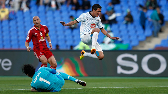 Monterrey's Neri Cardozo leaps to avoid sliding Al-Ahly goalkeeper Sherif Ekramy in Wednesday's FIFA Club World Cup fifth-place game. Cardozo scored in the Mexican side's 5-1 victory.