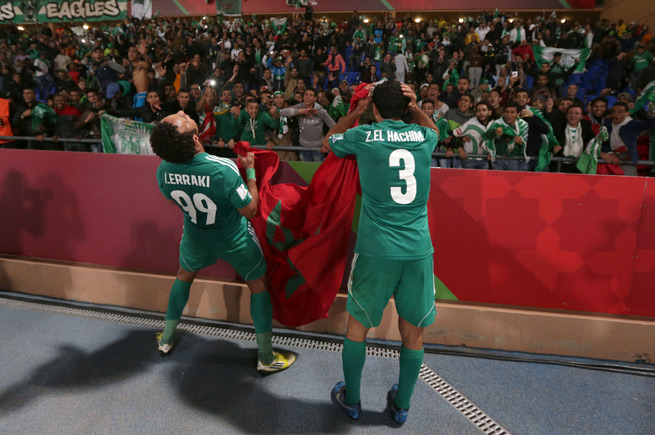 Raja Casablanca's Issam Eerraki, left, and teammate Zakaria El Hachimi celebrate after stunning Atletico Mineiro in the FIFA Club World Cup semifinals.