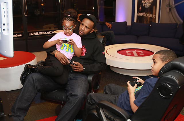 Warmed by baseball's hotstove, the Yankees hurler engaged in video games with his kids Jaden and Lil' C. at the CC & Amber Sabathia Holiday Party at MLB Fan Cave in New York City.