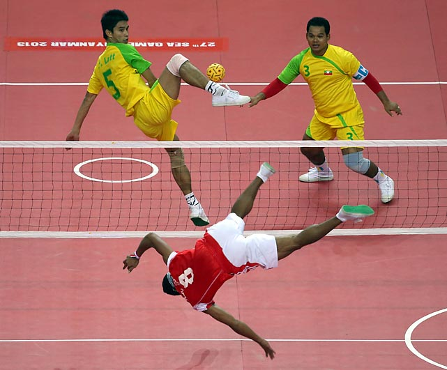 If you've never seen it, you'll probably flip over Sepak Takraw, the world's favorite kick volleyball game. Here we have a dramatic demonstration by Indonesia and Burma during the men's team doubles final at the Wunna Theikdi Indoor Stadium in Nay Pyi Taw, Burma, which is not to be confused with Burma Shave.