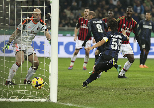 AC Milan's Christian Abbiati (left) could only watch as Rodrigo Palacio's winning goal went in.