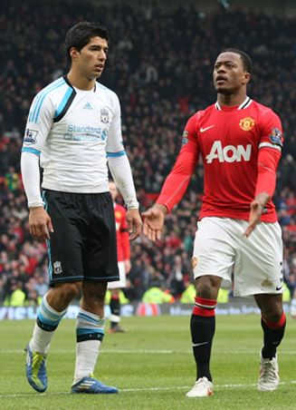 Luis Suarez got in hot water for a race row involving Manchester United's Patrice Evra, right, in October 2011.