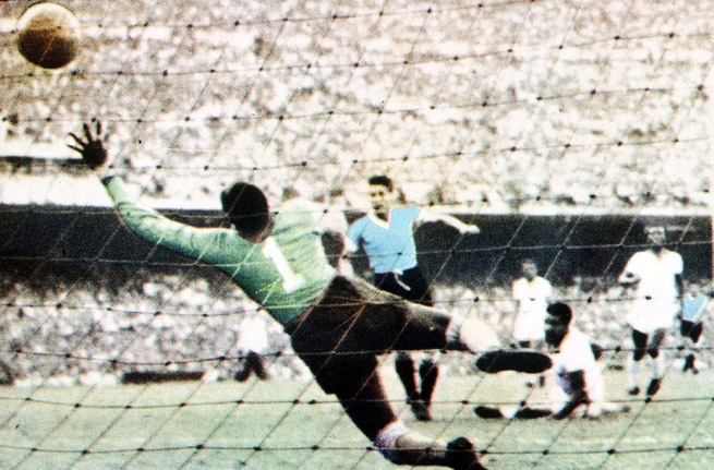 Juan Schiaffino scores Uruguay's first goal past Brazilian keeper Barbosa in the 1950 World Cup final at the Maracana Stadium in Rio de Janeiro.