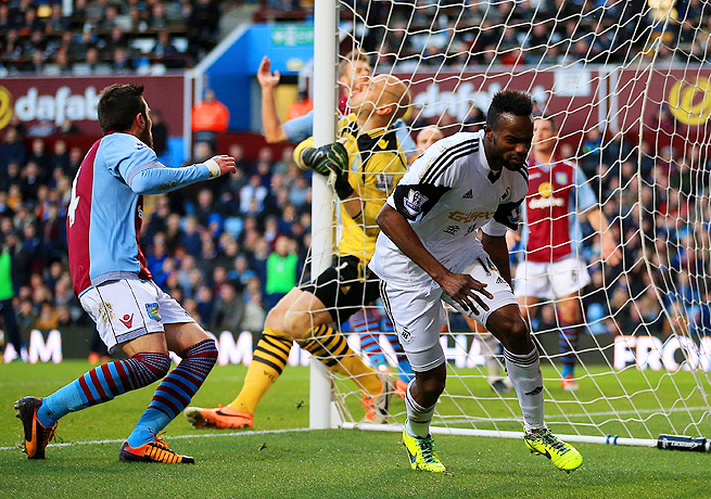 Roland Lamah (right) turned away from Aston Villa's goal after putting a header past Brad Guzan.