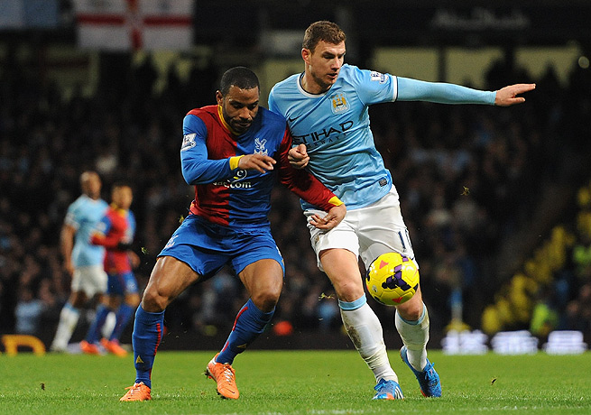Edin Dzeko (right) didn't start the game for Manchester City but came through when he was needed.