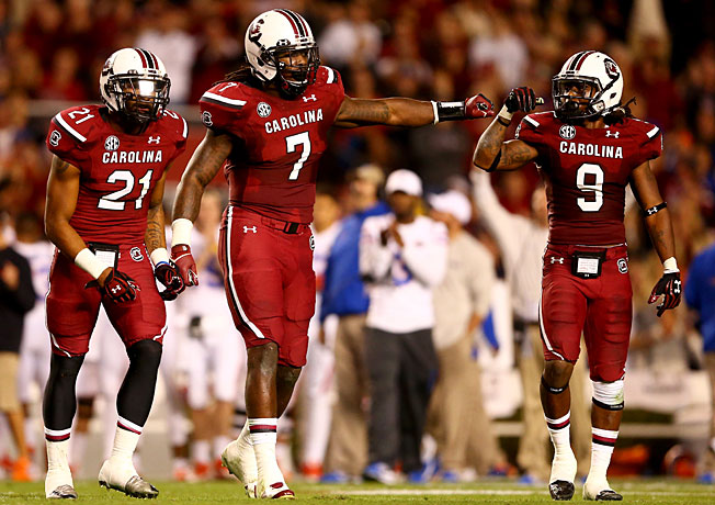 Jadeveon Clowney (7) and South Carolina's defense will look to slow Wisconsin's potent ground game.