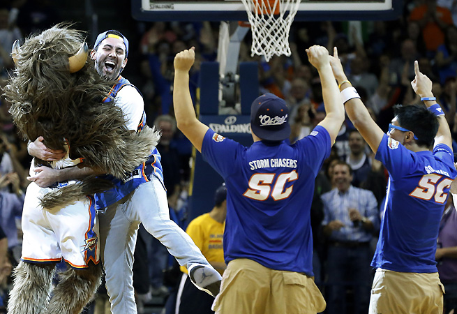 Cameron Rodriguez celebrates his half-court shot with Oklahoma City Thunder mascot Rumble.