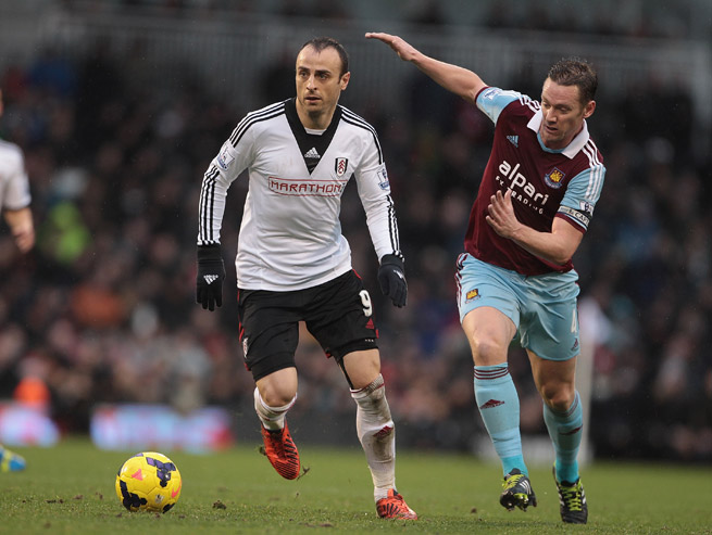 Fulham's Dimitar Berbatov, left, is tracked by West Ham's Kevin Nolan in the Cottagers' 2-1 victory Wednesday.