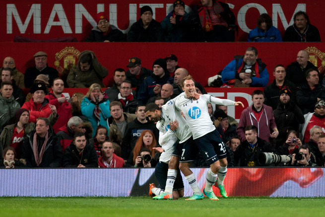 Christian Eriksen, right, celebrates with teammates after scoring the eventual game-winning goal in Tottenham's 2-1 victory at Manchester United.