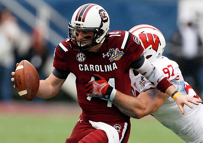 South Carolina quarterback Connor Shaw accounted for five touchdowns in a 34-24 win over Wisconsin.