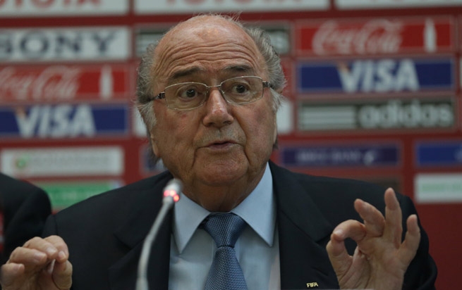 FIFA President Sepp Blatter was the subject of protests in Hong Kong, with the plight of migrant workers building the stadiums in Qatar the focus.