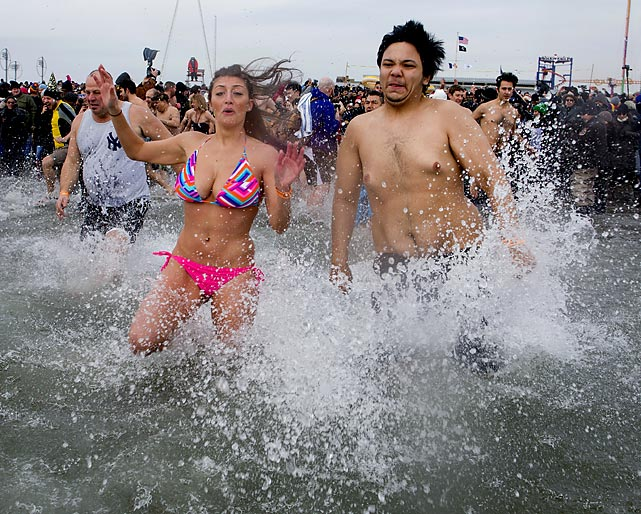 Swimsuit season is right around the corner and the first sign is traditionally seen at New York's Coney Island beach where for the last 111 years people have insisted on defying common sense.