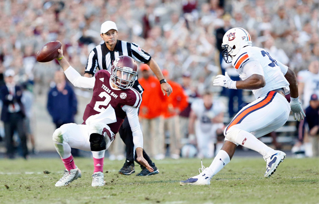 Dee Ford (right) sacked Johnny Manziel twice on A&M's last drive to seal Auburn's upset win earlier this season.