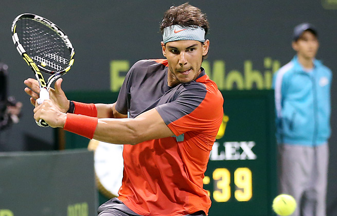 Rafael Nadal was forced into a deciding third set but still beat Gael Monfils to win the Qatar Open.