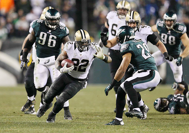 Mark Ingram (22) led a revitalized New Orleans rushing attack that ground down the Eagles' defense.