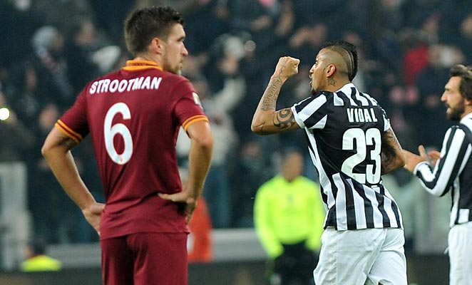 Arturo Vidal scored Juventus' first goal in a 3-0 win over nine-man Roma, ending their unbeaten run.