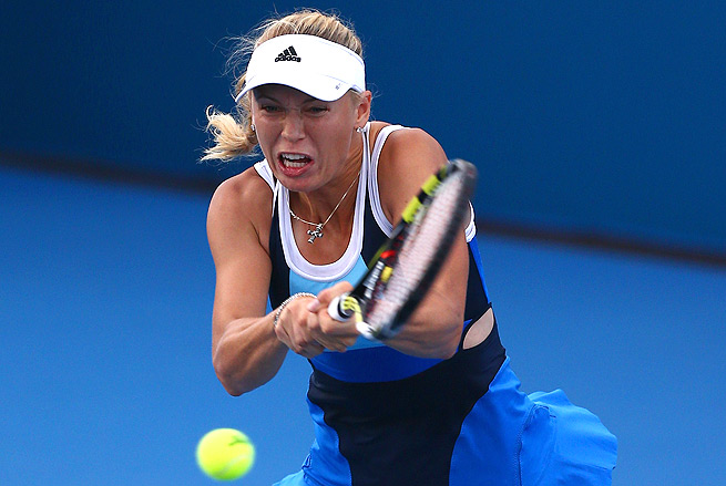 Caroline Wozniacki struggled at the start, but ousted Julia Goerges 3-6, 6-2, 6-4.