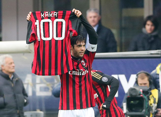 Kaka celebrates scoring his 100th goal for AC Milan with a commemorative jersey during Monday's win over Atalanta.