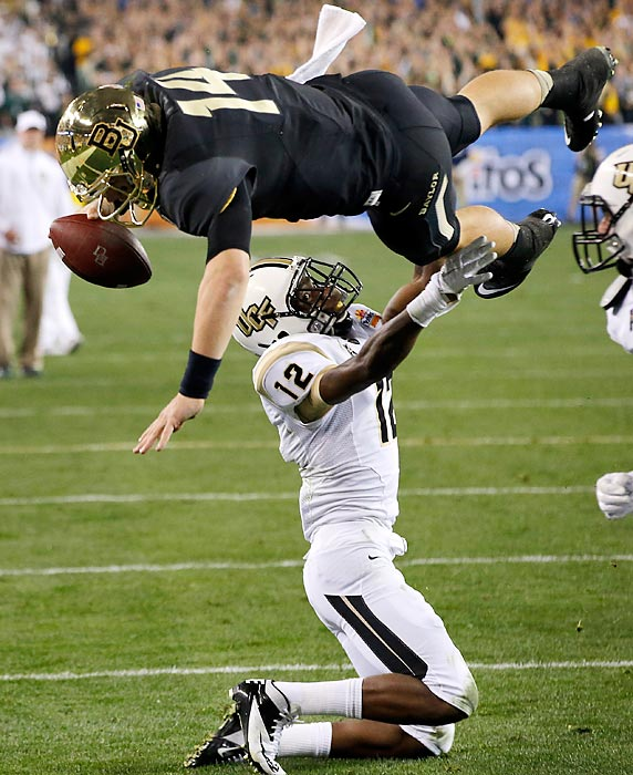 Baylor quarterback Bryce Petty dives over Central Florida defensive back Jacoby Glenn for a second-quarter touchdown in the 2014 Tostitos Fiesta Bowl. Even though Petty finished with five touchdowns, including three on the ground, Baylor eventually lost to UCF, 52-42.