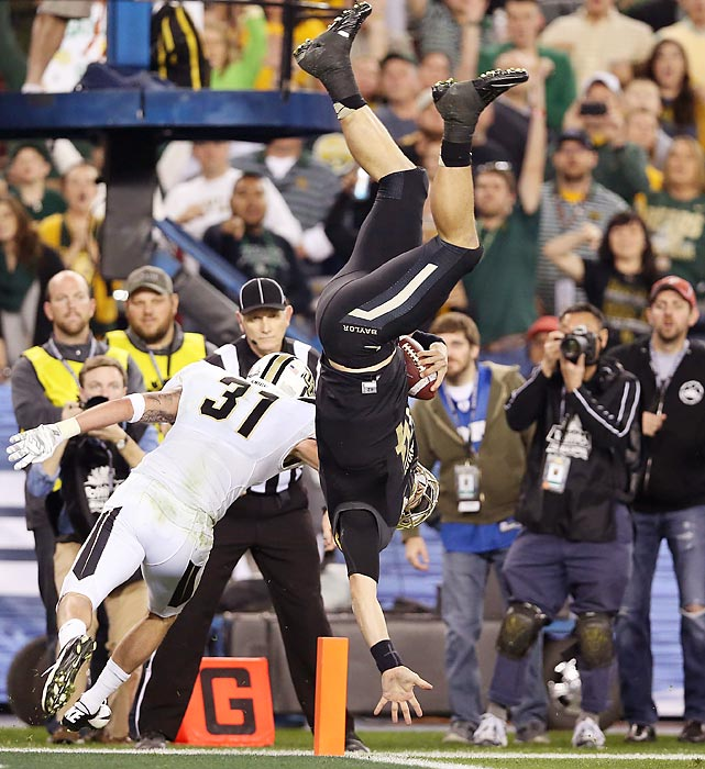 Though Baylor quarterback Bryce Petty found himself upside down near the end zone, his efforts were good enough to evade UCF defensive back Sean Maag and score a second-quarter 13-yard rushing touchdown. Petty's Bears eventually fell to the Golden Knights by a score of 52-42.