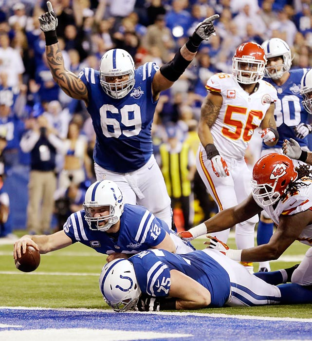 Indianapolis Colts quarterback Andrew Luck dives for a touchdown after scooping up a fumble by teammate Donald Brown in the fourth quarter of the team's wild-card playoff game. The touchdown and ensuing extra point cut Kansas City's lead to 41-38, helping the Colts rally from a 28-point deficit to beat the Chiefs 45-44.