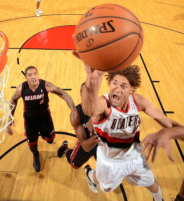 Portland Trail Blazers center Robin Lopez maneuvers around several Miami Heat defenders during a late December contest between NBA heavyweights in Portland. Though late in the game the Blazers led the Heat, which was playing without an injured LeBron James, a three-pointer from Chris Bosh with less than a second left gave Miami a 108-107 win.
