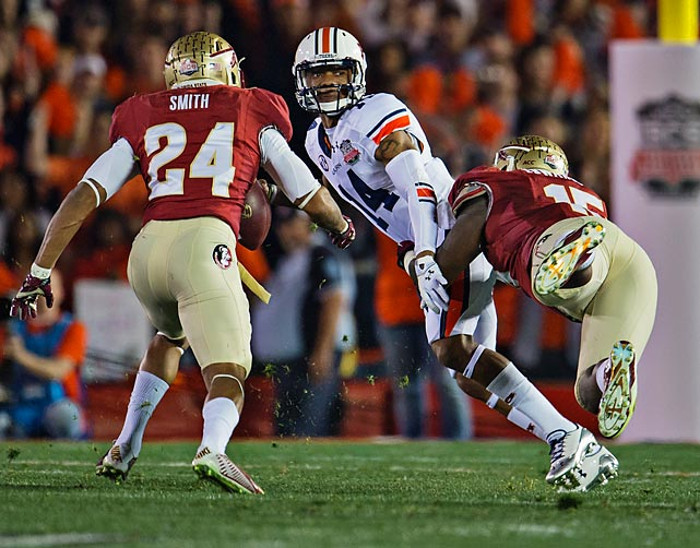 Marshall looks down the field with Florida State defenders in pursuit. Marshall finished the contest 14-27 for 217 yards with two touchdowns and one interception.