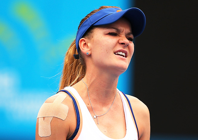 Agnieszka Radwanska expresses her frustration during her upset first round loss in Sydney.