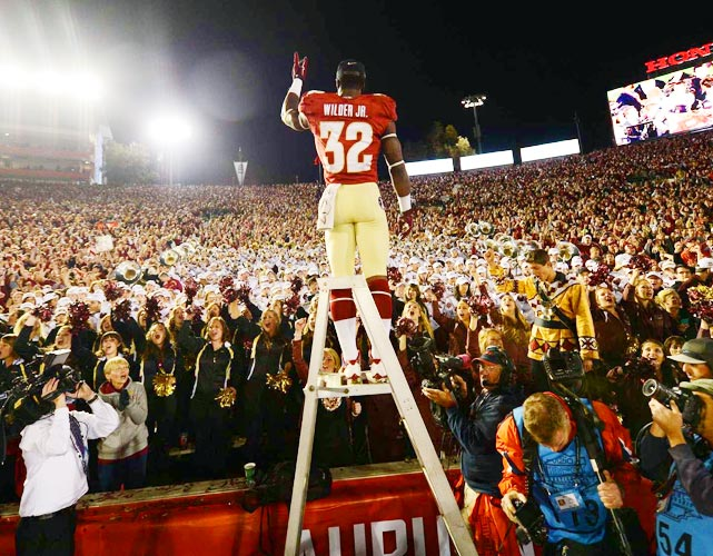 Running back James Wilder, Jr. led the Seminoles marching band during the postgame celebration.