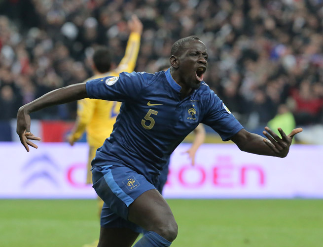Mamadou Sakho celebrates one of his two goals against Ukraine, which helped France overcome a two-goal deficit in their World Cup qualifying playoff.