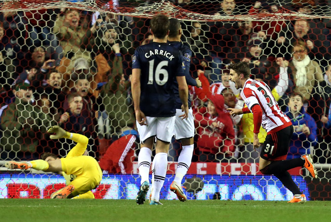 Sunderland's Fabio Borini, right, celebrates his game-winning goal that lifted the Black Cats to a 2-1 win over Manchester United in the first leg of the League Cup semifinals.