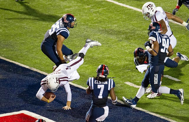 Manziel dives for a touchdown during Texas A&M's 41-38 win against Ole Miss on Oct. 12, 2013.