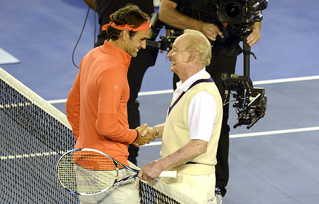 Roger Federer and Rod Laver (right) received a standing ovation by the 14,000 fans in Rod Laver Arena.