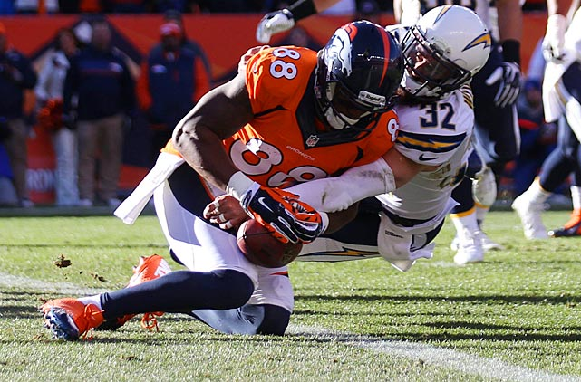 Demaryius Thomas managed to pin this ball against his leg for a catch and the Broncos' first touchdown.