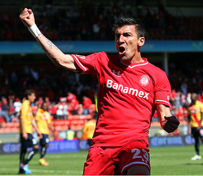 Toluca's Edgar Benitez celebrates his goal during his side's 2-2 draw with Morelia on Sunday