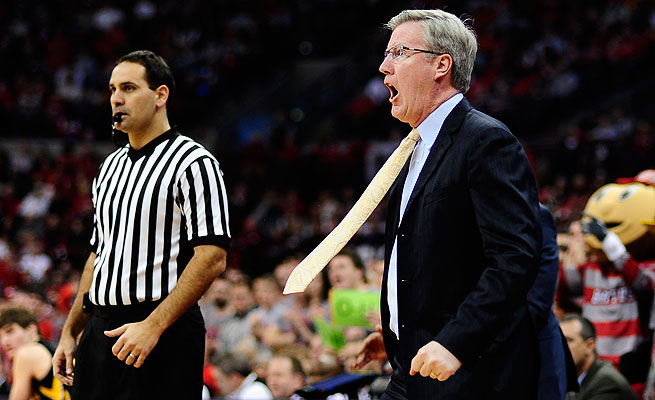 Fran McCaffery was suspended for a game following his bumping of an official during a loss to Wisconsin.