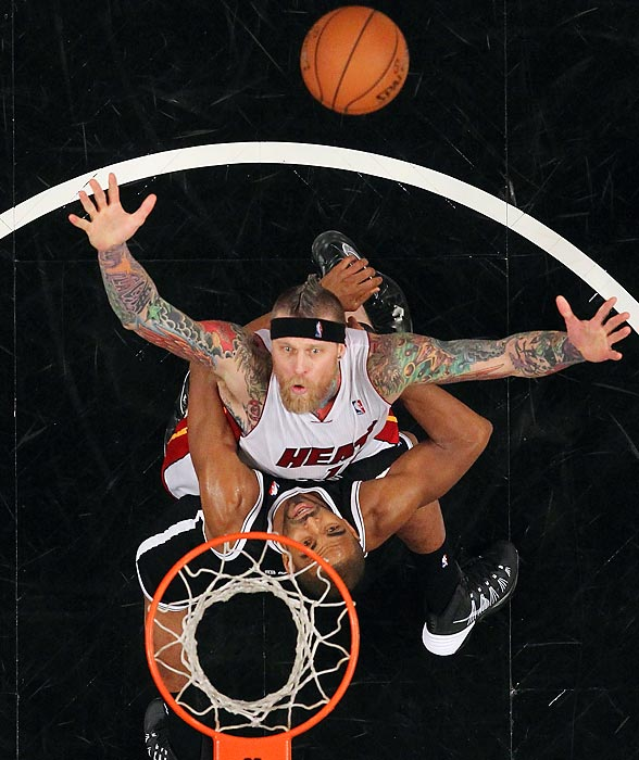 Chris Andersen of the Miami Heat and Alan Anderson of the Brooklyn Nets look to grab a rebound during a Jan. 10 contest in Brooklyn. The Nets prevailed 104-95 in double overtime.
