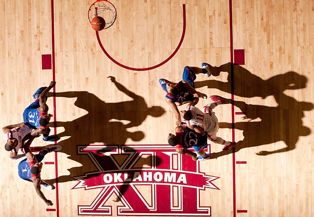 Kansas players box out Oklahoma's after a free throw attempt in a Jan. 7 game in Norman, Okla. Kansas won 90-83.