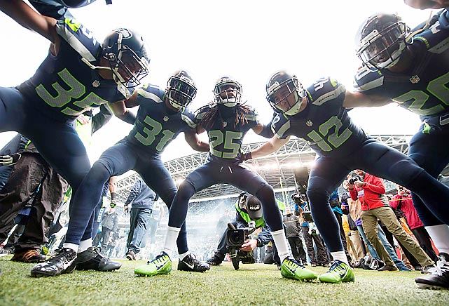 The defensive backs unit of the Seattle Seahawks huddles up prior to their playoff game against the New Orleans Saints. The Seahawks held the Saints scoreless until the fourth quarter, when a late New Orleans rally fell short as Seattle advanced to the NFC Championship with a 23-15 victory.