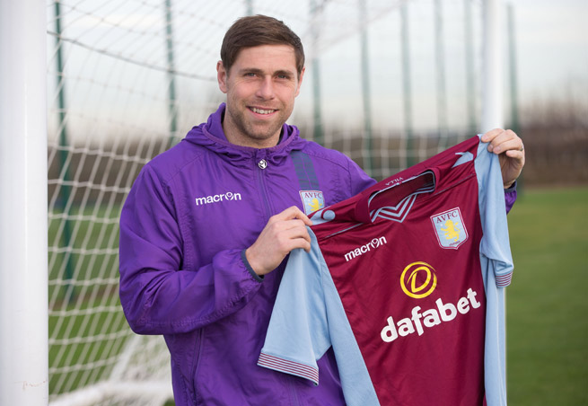 Grant Holt holds up an Aston Villa jersey after joining the club on loan from Wigan Athletic for the remainder of the season.