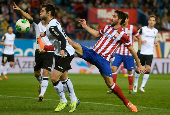 Raul Garcia scored the second goal as Atlético Madrid defeated Valencia to head to the quarterfinals