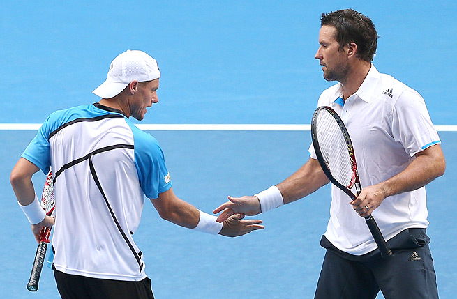 Doubles partners Pat Rafter (right) and Lleyton Hewitt lost in straight sets to Eric Butorac and Raven Klassen.