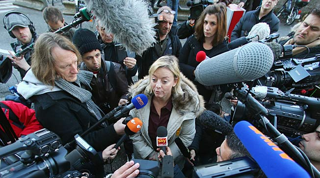 Michael Schumacher's manager Sabine Kehm (center) broke an uneasy silence on his condition.
