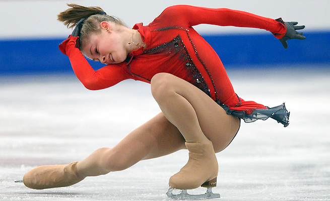 Julia Lipnitskaia, 15, made a golden debut with a dazzling free skate program to move up from second.