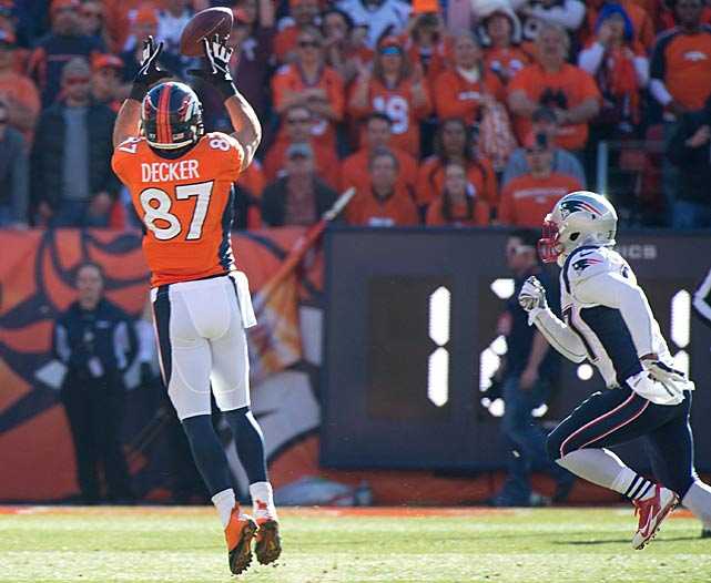 Eric Decker goes high for one of his five receptions.