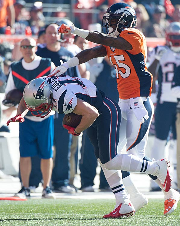 Julian Edelman gets knocked down from behind.